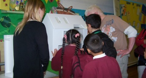 Pupils playing with the Eco house